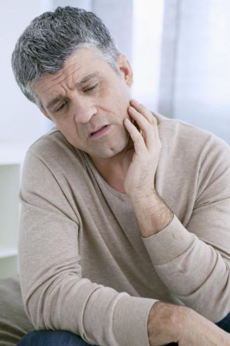 Man with Jaw Pain | TMJ treatment Avondale Dental Centre