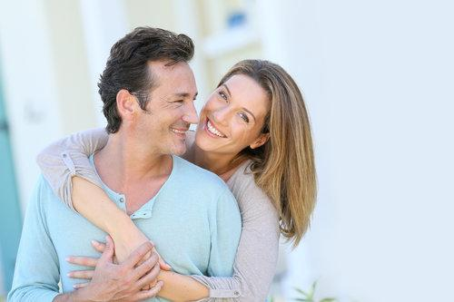 Couple smiling | Avondale dental implants